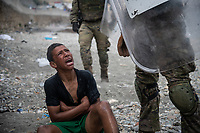 CEUTA, SPAIN ‐ MAY 19: A migrant reacts as he talks to Spanish soldiers on the Tarajal beach after being intercepted when he was swimming across the border between Morocco and Spain on May 19, 2021 in Ceuta, Spain.  After a diplomatic conflict between Spain and Morocco, thousands of migrants who have taken advantage of the little Moroccan police activity on the border to cross it mainly by swimming, which has caused a migration crisis with the entry of more than 8000 migrants from the African country. (Photo by Joan Amengual/VIEWpress )