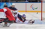 Sochi, RUSSIA - Mar 13 2014 - Kevin Rempel watches as a puck approaches the USA net as Canada takes on USA in Sledge Hockey Semi-Final at the 2014 Paralympic Winter Games in Sochi, Russia.  (Photo: Matthew Murnaghan/Canadian Paralympic Committee)