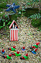 29/05/15<br /> <br /> That's the way to do it - Punch and Judy.<br /> <br /> For one group of hardy folk, today's rain only adds to the fun that can be had by the beach, fishing in the river, or playing in the woods.<br /> <br /> The gnomes, and a few pixies and fairies, make up a collection, now believed to be close to 2,000 individuals, that 'live' at the Gnome Reserve near Bideford, North Devon.<br /> <br /> Visitors are asked to wear gnome hats, so as not to scare the gnomes who feature as the largest collection in the Guinness Book of World Records. <br /> <br /> Ann Atkin's collection began in 1979 and features traditional gnomes on toad-stools to Olympian athletes, astronauts who work for 'GNASA', a beach scene complete with gnomes in bikinis, a queue for the ice-cream van, Punch and Judy gnomes and another floating on a lilo. Other gnomes can be scene kissing, and flashing their bottoms as the visit the Gents and Ladies toilets. <br /> <br /> <br /> All Rights Reserved - F Stop Press.  www.fstoppress.com. Tel: +44 (0)1335 418629 +44(0)7765 242650