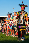 Dancers enter the arena during the Grand Entry, the beginning of the evening powwow at Crow Fair.