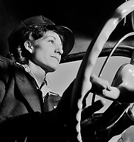 Portrait of a woman training to operate buses and taxicabs, 1942.<br /> <br /> Photo by Andreas Feininger.