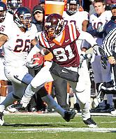 Nov 27, 2010; Charlottesville, VA, USA;  Virginia Tech Hokies wide receiver Jarrett Boykin (81) runs past Virginia Cavaliers linebacker Ausar Walcott (26) during the game at Lane Stadium. Virginia Tech won 37-7. Mandatory Credit: Andrew Shurtleff