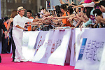 Man Wenjun (hat), Ricky Chan (blue jacket), Huang Gexuan (sunglasses), Danny Lau (necktie), and Cindy Lee walk the Red Carpet event at the World Celebrity Pro-Am 2016 Mission Hills China Golf Tournament on 20 October 2016, in Haikou, China. Photo by Victor Fraile / Power Sport Images