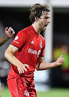 LAKE BUENA VISTA, FL - JULY 26: Patrick Mullins of Toronto FC reacts to his shot go in the goal during a game between New York City FC and Toronto FC at ESPN Wide World of Sports on July 26, 2020 in Lake Buena Vista, Florida.