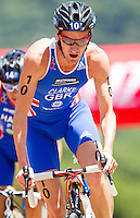 27 MAY 2012 - MADRID, ESP - Will Clarke (GBR) of Great Britain on the bike during the elite men's 2012 World Triathlon Series round in Casa de Campo, Madrid, Spain (PHOTO (C) 2012 NIGEL FARROW)