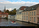 Canal Scene: Tourist Boat on the Sint-Annarei at Langestraat, Sint-Annakerk in the distance, Bruges, Brugge, Belgium
