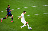 CARSON, CA - JUNE 19: Sacha Kljestan #16 of the Los Angeles Galaxy clearing a ball during a game between Seattle Sounders FC and Los Angeles Galaxy at Dignity Health Sports Park on June 19, 2021 in Carson, California.