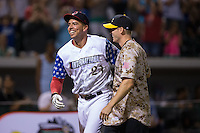 Chris Marrero (left) of the Pawtucket Red Sox celebrates with his pitcher, Mike Moore, after winning the 29th Annual Triple-A Home Run Derby at BB&T BallPark on July 11, 2016 in Charlotte, North Carolina.  Marrero defeated Kyle Jensen (not pictured) of the Reno Aces 18-17.  (Brian Westerholt/Four Seam Images)