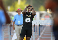 American Heritage runner Walter Tucker, (27), reacts after he just catches his foot on the top of the hurdle causing him to crash as he had the lead in the mens 110 Meter Hurdles final during the FHSAA Class 2A Track and Field Finals at the University of North Florida in Jacksonville, Florida Saturday April 28, 2012.(Kelly Jordan)