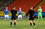 Dundee United v St Johnstone…12.01.21   Tannadice     SPFL<br />Shaun Rooney, Ali McCann and Zander Clark join the United players in a minutes applause in memory of Jim McLean<br />Picture by Graeme Hart.<br />Copyright Perthshire Picture Agency<br />Tel: 01738 623350  Mobile: 07990 594431