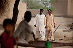 25 JULY 2011: Basti Mahraan Village, Punjab, Pakistan.    Mahar Abdul Latif (L), a former member of Muslim terrorist group Lashkar-i-Taiba (LeT) at his home village of Basti Mahraan in Pakistan with fellow villager Bachu Ram, a Hindu. After Ram offered to donate his rare blood type to save the life of a muslim woman, relations thawed in the traditional violence between the Muslims and Hindu's of the village. Picture by Graham Crouch/Toronto Star