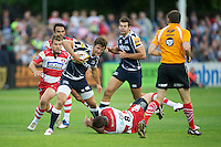 20120803 Copyright onEdition 2012©.Free for editorial use image, please credit: onEdition..Tom Brady of Sale Sharks is tackled by Dave Lewis of Gloucester Rugby at The Recreation Ground, Bath in the Final round of The J.P. Morgan Asset Management Premiership Rugby 7s Series...The J.P. Morgan Asset Management Premiership Rugby 7s Series kicked off again for the third season on Friday 13th July at The Stoop, Twickenham with Pool B being played at Edgeley Park, Stockport on Friday, 20th July, Pool C at Kingsholm Gloucester on Thursday, 26th July and the Final being played at The Recreation Ground, Bath on Friday 3rd August. The innovative tournament, which involves all 12 Premiership Rugby clubs, offers a fantastic platform for some of the country's finest young athletes to be exposed to the excitement, pressures and skills required to compete at an elite level...The 12 Premiership Rugby clubs are divided into three groups for the tournament, with the winner and runner up of each regional event going through to the Final. There are six games each evening, with each match consisting of two 7 minute halves with a 2 minute break at half time...For additional images please go to: http://www.w-w-i.com/jp_morgan_premiership_sevens/..For press contacts contact: Beth Begg at brandRapport on D: +44 (0)20 7932 5813 M: +44 (0)7900 88231 E: BBegg@brand-rapport.com..If you require a higher resolution image or you have any other onEdition photographic enquiries, please contact onEdition on 0845 900 2 900 or email info@onEdition.com.This image is copyright the onEdition 2012©..This image has been supplied by onEdition and must be credited onEdition. The author is asserting his full Moral rights in relation to the publication of this image. Rights for onward transmission of any image or file is not granted or implied. Changing or deleting Copyright information is illegal as specified in the Copyright, Design and Patents Act 1988. If you are in any way unsure of your right to publish t
