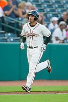 Jose Behar (15) of the Greensboro Grasshoppers jogs down the third base line after hitting a home run against the Charleston RiverDogs at NewBridge Bank Park on July 17, 2013 in Greensboro, North Carolina.  The Grasshoppers defeated the RiverDogs 4-3.  (Brian Westerholt/Four Seam Images)