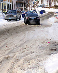 WATERBURY CT. - 18 December 2020-121820SV12-A vehicle spins it tires on West Farms Street in the city's north end in Waterbury Friday.<br /> Steven Valenti Republican-American