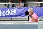 The Hague, Netherlands, June 14: Male photographer looks on during the field hockey gold medal match (Women) between Australia and The Netherlands on June 14, 2014 during the World Cup 2014 at Kyocera Stadium in The Hague, Netherlands. Final score 2-0 (2-0)  (Photo by Dirk Markgraf / www.265-images.com) *** Local caption ***
