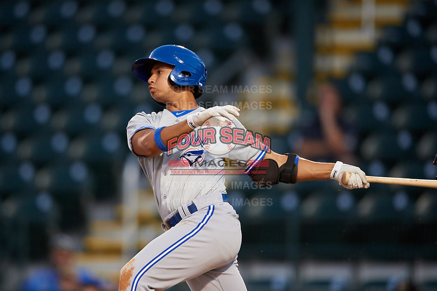 Dunedin Blue Jays second baseman Yeltsin Gudino (5) follows through on a swing during a game against the Bradenton Marauders on May 2, 2018 at LECOM Park in Bradenton, Florida.  Bradenton defeated Dunedin 6-3.  (Mike Janes/Four Seam Images)