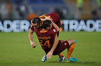 Calcio, Serie A: Roma vs Inter. Roma, stadio Olimpico, 2 ottobre 2016.<br /> Roma's Kostas Manolas, right, is hugged by his teammate Alessandro Florenzi after scoring the winning goal during the Italian Serie A football match between Roma and FC Inter at Rome's Olympic stadium, 2 October 2016. Roma won 2-1.<br /> UPDATE IMAGES PRESS/Isabella Bonotto