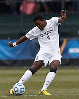 University of Connecticut midfielder George Fochive (9) clears the ball. .NCAA Tournament. Creighton University (blue) defeated University of Connecticut (white), 1-0, at Morrone Stadium at University of Connecticut on December 2, 2012.