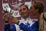 Jockey Gérald Mossé (left) and Ms Carina Klingberg head of the Pride Racing Club