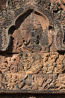 Banteay Srei with bas relief in red sandstone showing Ravana shaking Mount Kailasa & Shiva & Parvati (E pediment of S Library), 10th century Khmer architecture at Angkor Wat -  Siem Reap, Cambodia...
