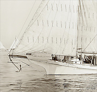 """Chesapeake Bay Skipjack America sails again in Bill Peterson's digitally restored sepia image from the 1967 Deal Island Skipjack race. One of  the Limited Edition Skipjack prints from the Fine Art """"Skipjack Sunday"""" collection."""