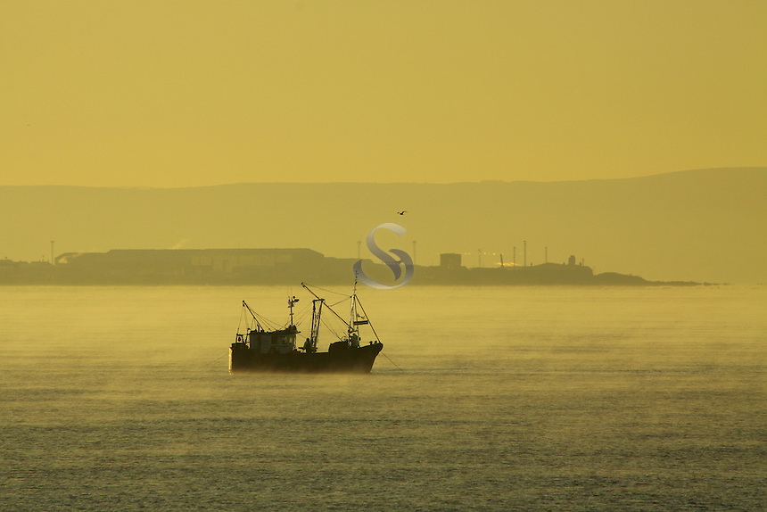 A fishing trawler at dawn at Irvine, Ayrshire<br /> <br /> Copyright www.scottishhorizons.co.uk/Keith Fergus 2011 All Rights Reserved