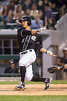Tyler Saladino (8) of the Charlotte Knights follows through on his swing against the Indianapolis Indians at BB&T Ballpark on May 23, 2014 in Charlotte, North Carolina.  The Indians defeated the Knights 15-6.  (Brian Westerholt/Four Seam Images)