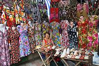 REPUBLIC OF MOLDOVA, Gagauzia, Comrat, 2009/06/26..A saleswoman of colorful dresses on the market of Comrat. Capital of Gagauzia, Comrat is the main market of the autonomous region. Each morning, tens of thousands come from all over the Gagauz region sourcing manufactured goods and clothing came directly from China..© Bruno Cogez / Est&Ost Photography..REPUBLIQUE MOLDAVE, Gagaouzie, Comrat, 26/06/2009..Une vendeuse de robes colorees sur le marche de Comrat. Capitale de la Gagaouzie, Comrat est le principal marche de la région autonome. Chaque matin, des dizaines de milliers de Gagaouzes viennent de toute la region s'approvisionner en produits manufactures et en vetements venus directement de Chine..© Bruno Cogez / Est&Ost Photography
