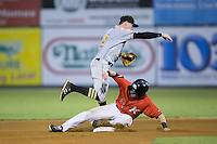 Mitchell Tolman (5) of the West Virginia Power makes a throw to first base as Danny Mendick (14) of the Kannapolis Intimidators slides into second base at Kannapolis Intimidators Stadium on August 20, 2016 in Kannapolis, North Carolina.  The Intimidators defeated the Power 4-0.  (Brian Westerholt/Four Seam Images)
