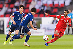 Minamino Takumi of Japan (C) competes for the ball with Khalid Al Braiki of Oman (R) during the AFC Asian Cup UAE 2019 Group F match between Oman (OMA) and Japan (JPN) at Zayed Sports City Stadium on 13 January 2019 in Abu Dhabi, United Arab Emirates. Photo by Marcio Rodrigo Machado / Power Sport Images