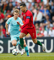 Cristiano Ronaldo of Portugal and Frenkie de Jong of Netherlands during the UEFA Nations League Final match between Portugal and Netherlands at Estadio do Dragao on June 9th 2019 in Porto, Portugal. (Photo by Daniel Chesterton/phcimages.com)<br /> Finale <br /> Portogallo Olanda<br /> Photo PHC/Insidefoto <br /> ITALY ONLY