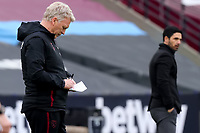 21st March 2021; London Stadium, London, England; English Premier League Football, West Ham United versus Arsenal; West Ham United Manager David Moyes makes notes