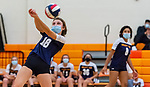 PLYMOUTH, CT-111020JS18 —Wolcott Tech's Zoe Orie (18) gets the ball over then net while teammate Yennifer Sarmiento (8) looks on during their match against Terryville Tuesday at Terryville High School. <br /> Jim Shannon Republican-American