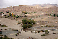 A view of the Bamiyan Valley from the airport with the burn face of the 54 meters Buddha and the decapitate 34 meters Bamiyan Buddha in 1999. .The blow up was made with explosive behind the head causing the decapitation and collapse of all main fresco in the niche of the 34 meters Buddha..The Taleban started to seriously destroy the Bamiyan Buddha in autumn of 1999.