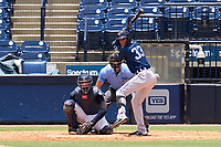 Lakeland Flying Tigers outfielder Carlos Pelegrin (33) bats during a game against the Tampa Tarpons on July 18, 2021 at George M. Steinbrenner Field in Tampa, Florida.  Also shown, catcher Carlos Narvaez (5) and umpire Michael Corbett.  (Mike Janes/Four Seam Images)