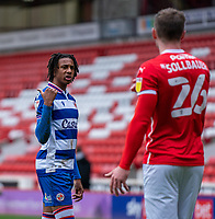 2nd April 2021, Oakwell Stadium, Barnsley, Yorkshire, England; English Football League Championship Football, Barnsley FC versus Reading; Michael Olise of Reading in discussions with Michael Sollbauer of Barnsley