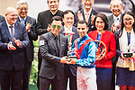 Jockey Joao Moreira, who rides Rapper Dragon, is presented a trophy by actor Donnie Yen after winning 2017 BMW Hong Kong Derby Race at the Sha Tin Racecourse on 19 March 2017 in Hong Kong, China. Photo by Marcio Rodrigo Machado / Power Sport Images