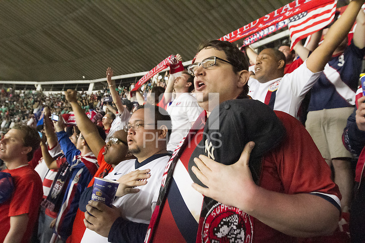 USA fans sing the American national anthem at Azteca stadium before the USA vs. Mexico World Cup Qualifier in Mexico City, Mexico on March 26, 2013.