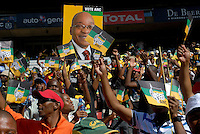 Crowds wave ANC flags and hold up pictures of Jacob Zuma at an African National Congress (ANC) election rally held at the Ellis Park Stadium in Johannesburg..