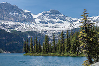 Boom Lake is formed by massive limestone walls and glacier-mantled peaks in Banff National Park