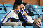 Kilmarnock fans with branded face masks. Kilmarnock 2 Ayr United 0, Scottish Championship, August 2nd 2021. Following Kilmarnock's relegation in 2020-21, the first game of the new season is the Ayreshire Derby, the first league match between the teams in 28 years. Due to relaxation of Covid restrictions the match was played in front of a crowd of 3200 Kilmarnock fans. The game was shown live on BBC Scotland.