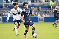KANSAS CITY, KS - MAY 16: Cameron Duke #28 Sporting KC with the ball during a game between Vancouver Whitecaps and Sporting Kansas City at Children's Mercy Park on May 16, 2021 in Kansas City, Kansas.