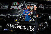 Sept. 18, 2011; Concord, NC, USA: NHRA pro mod driver Leah Pruett (left) celebrates with team owner Roger Burgess after winning the O'Reilly Auto Parts Nationals at zMax Dragway. Mandatory Credit: Mark J. Rebilas-