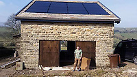 BNPS.co.uk (01202 558833)<br /> Pic: BNPS<br /> <br /> The property taking shape during the build.<br /> <br /> A resourceful couple have made a £150,000 profit after knocking down a derelict old farm building and constructing an impressive eco-friendly retreat in its place.<br /> <br /> Art technician Danielle Coates, 33, and her husband Ben, 33, a carpenter, have created The Rookery, in the scenic village of Roughlee, East Lancs.<br /> <br /> They spent £200,000 buying six acres of farmland and building the two bedroom detached stone home. It has been a shrewd investment as the property, which was completed in 2015, is now valued at £350,000.<br /> <br /> They are currently renting out the two bedroom cottage as a holiday let on cottages.com, with it generating an annual turnover of £50,000.<br /> <br /> Original stones from the demolished farm building have been incorporated into the new structure. Solar panels have been fitted to generate enough energy to run the entire house, and recycled timber from the farm used to fashion shelves and handles.