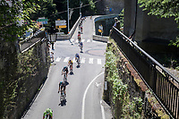 yellow jersey/ GC leader Richie Porte (AUS/BMC) got isolated from teammates in a thinned out peloton coming down the Col des Saisies & diving into the little town of Flumet<br /> <br /> 69th Critérium du Dauphiné 2017<br /> Stage 8: Albertville > Plateau de Solaison (115km)