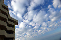 Morning sun and clouds begin to bring light to a hotel at Virginia Beach, Va.