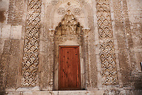 Door of Gök Medrese which has a very rich decorative appearance. Its islamic Muqarnas corbelled vault is made up of a large number of miniature squinches, producing a sort of cellular structure. The crown gate of Gök Medrese is one of the best examples of Sejuk architecture in Anatolia, Sivas, Turkey