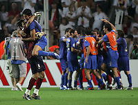 Italian defender (3) Fabio Grosso and goalkeeper (1) Gianluigi Buffon celebate the game-winning goal.  Italy defeated Germany, 2-0, in overtime in their FIFA World Cup semifinal match at FIFA World Cup Stadium in Dortmund, Germany, July 4, 2006.