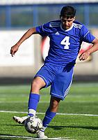 NWA Democrat-Gazette/CHARLIE KAIJO Rogers High School Esteban Chavez (4) dribbles during a soccer game, Friday, April 26, 2019 at  Whitey Smith Stadium at Rogers High School in Rogers.