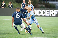 FOXBOROUGH, MA - SEPTEMBER 29: Brandon Bye #15 of New England Revolution and Carles Gil #22 of New England Revolution pressure Alexandru Mitrita #28 of New York City FC during a game between New York City FC and New England Revolution at Gillettes Stadium on September 29, 2019 in Foxborough, Massachusetts.